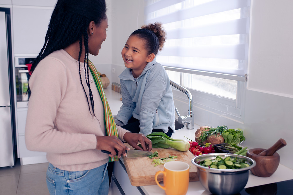 Mom and daughter spending quality time together at the kitchen