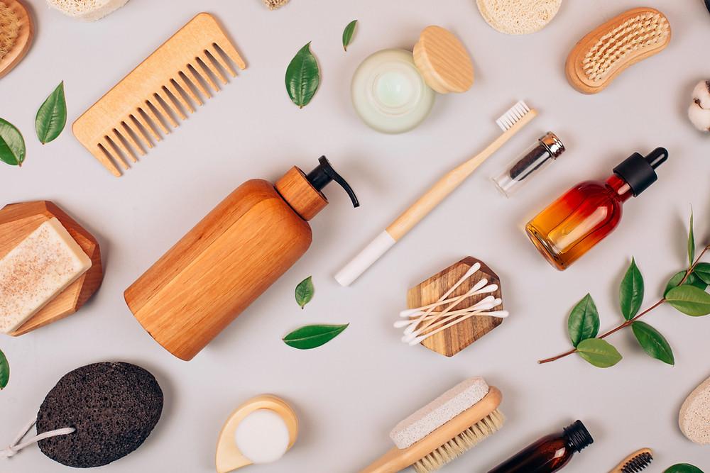 Plastic free bathroom essentials. Shampoo bar, conditioner bar, soap, bamboo cotton buds, nail brush, bamboo comb, konjac sponge.