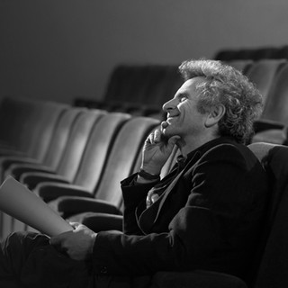 Man in Theater with Script