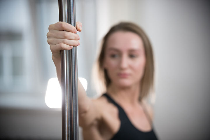 Girl Holding a Dancing Pole