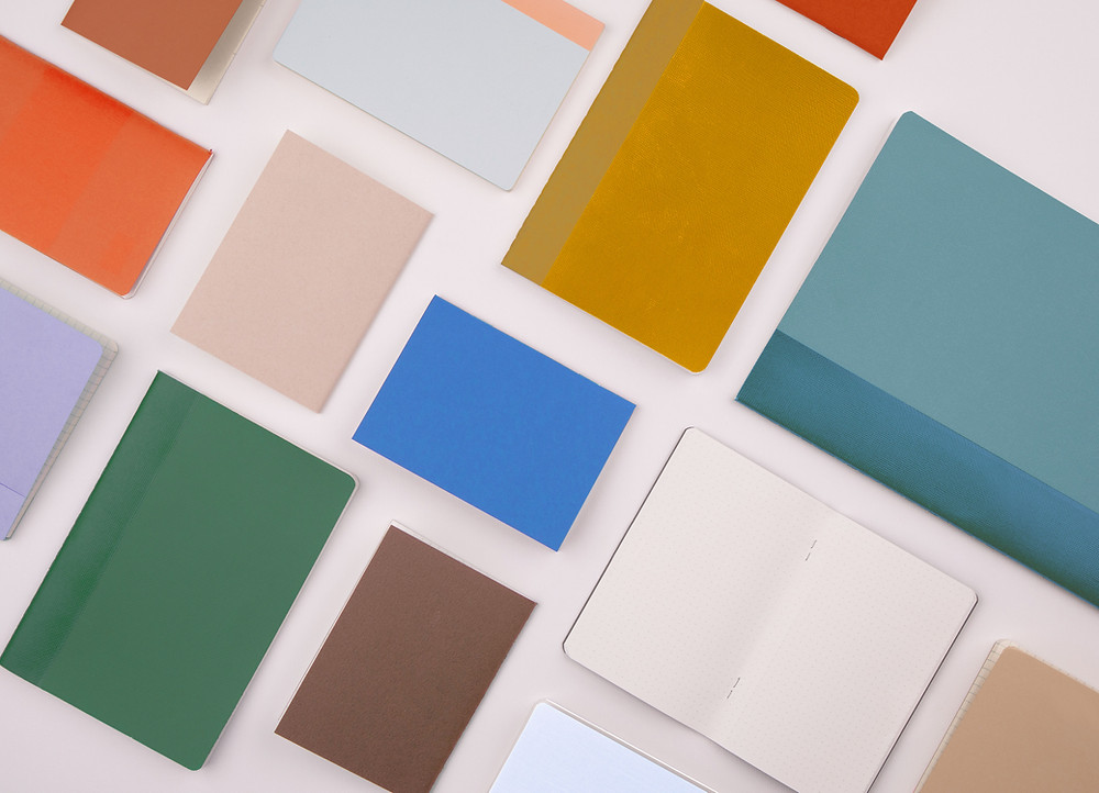 Various coloured notebooks