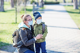 Mother and Child wearing masks