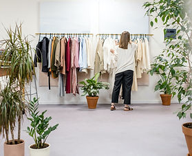 a girl working in a clothing store