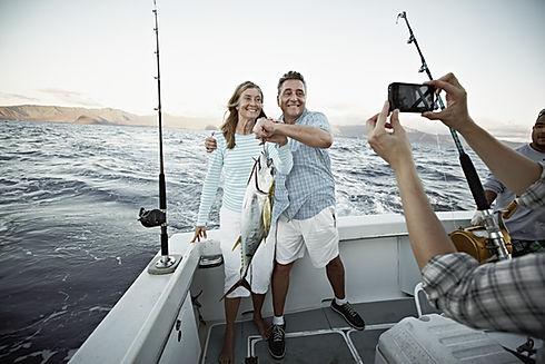 Couple Holding Fish