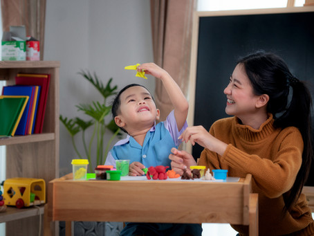 Are crafts and 3-course meals the definition of a good parent?