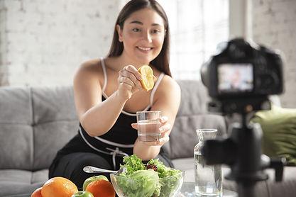 Woman Squeezing Lemon