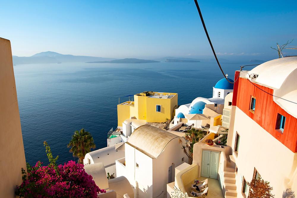 Wide shot of Santorini, Greece & the ocean