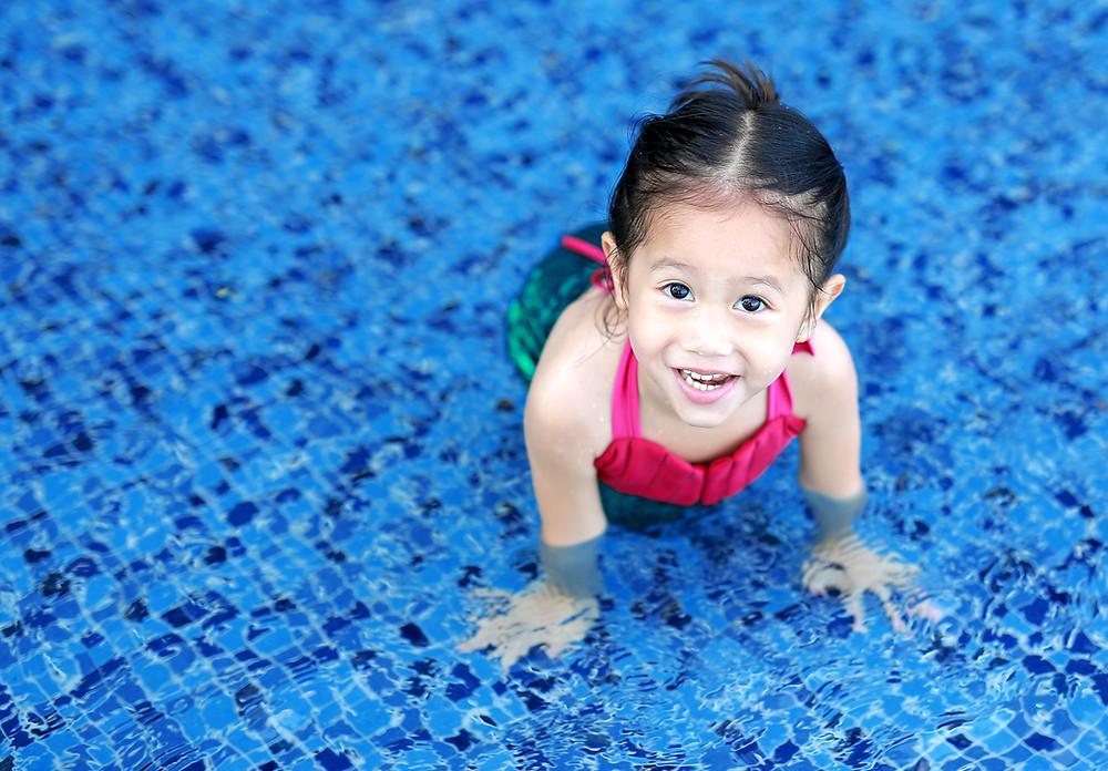 Cute girl swimming