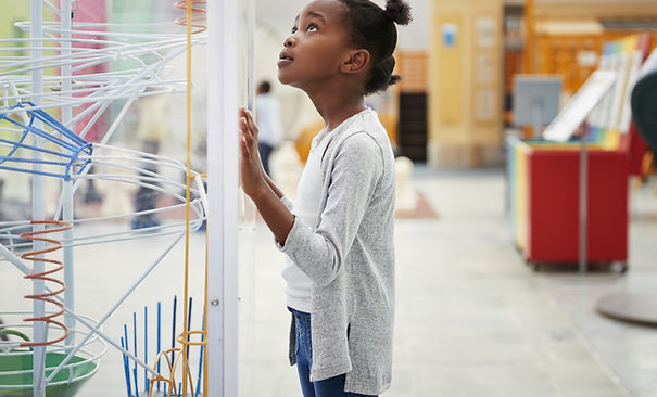 A Girl Looking at a Physics Model