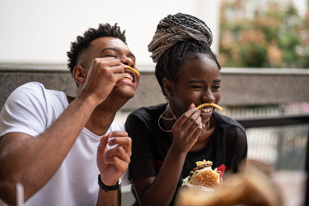 Couple eating chips and laughing together
