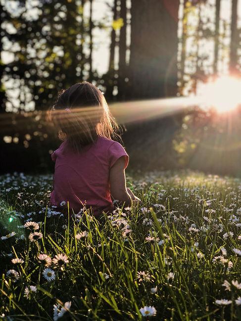Girl in Daisies Field