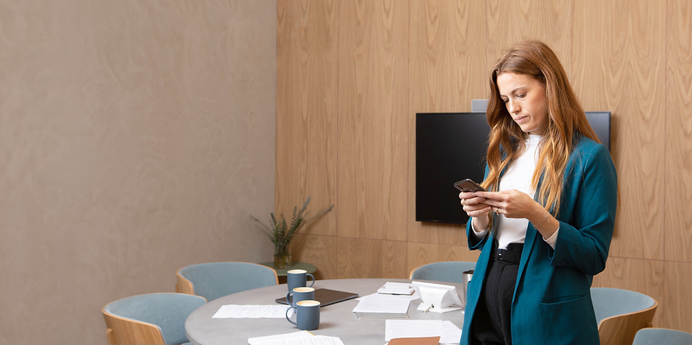 Female Leader reading a text in the meeting room