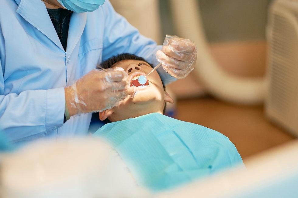 Kid Receiving Dental Treatment