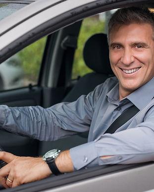 Businessman Driving a Car