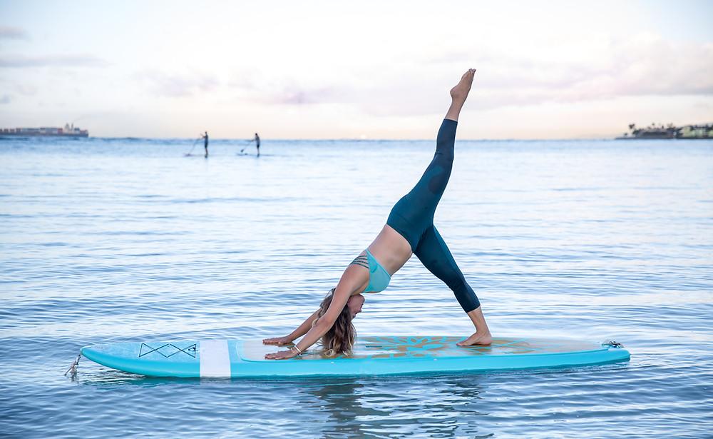paddle board yoga. Wellbeing image. beautiful view, abundance, health, wellbeing.