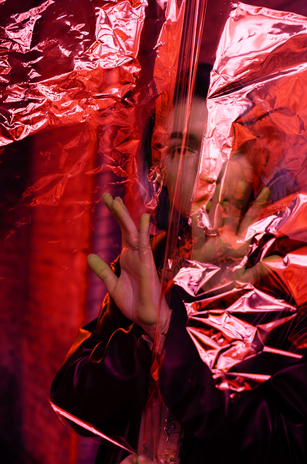 Woman standing behind red transparent foil