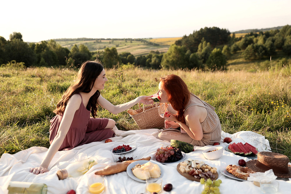two girlfriends having a picnic