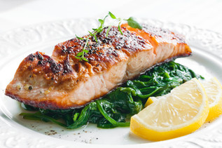 Pan fried Salmon fillet, braised green vegetables. Private dinner for two.
