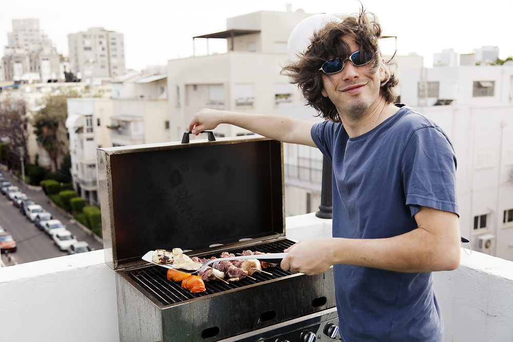 guy cooking barbecue in miami
