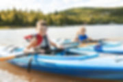 Children Kayaking on River