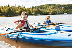 Children Kayaking on River