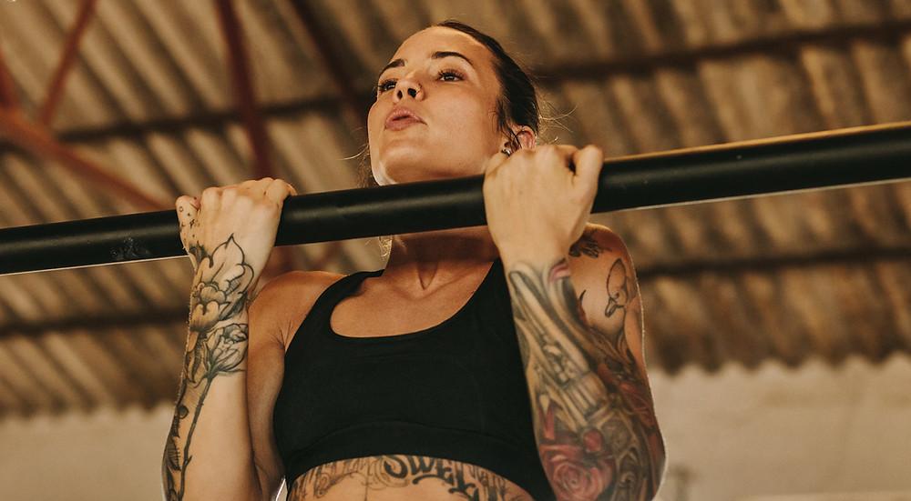 Woman exercising - chin ups