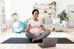 Maternity Yoga with Computer and Mat