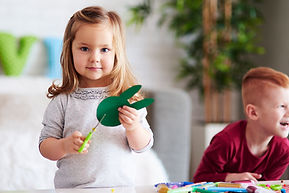 [Image description: A photo of two young children doing crafts.]