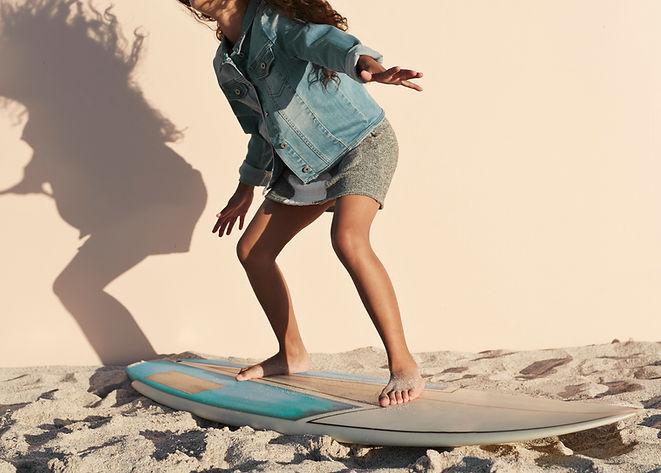 Girl Posing on Surfboard