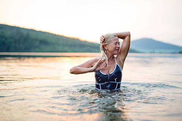 An Older Woman Bathing in. the Sea