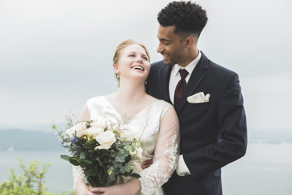 Newlyweds smyling as they decide to elope abroad and have intimate wedding