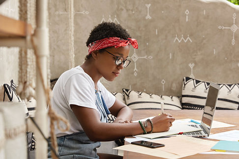 A Young Woman Writing