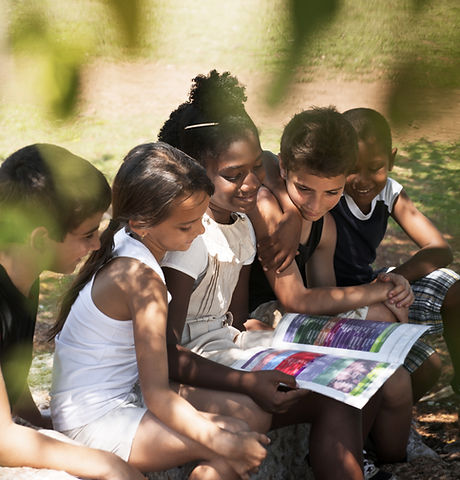 Kids Reading Book in Park