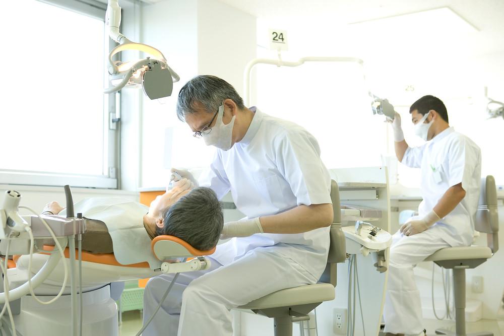 dentist working on patient, biohazard waste