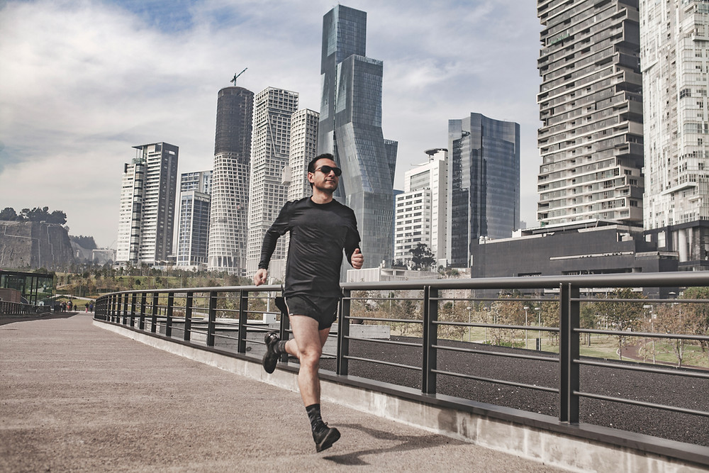 man running in the city doing cardio