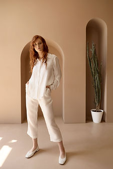 Woman in White Suit