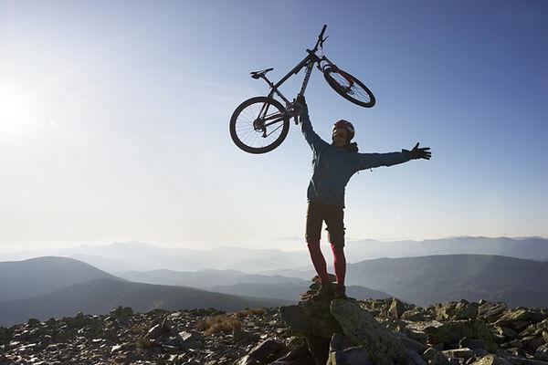 Biker on Mountain Top