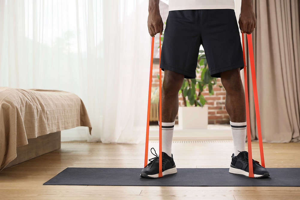 man using resistance bands during home workout