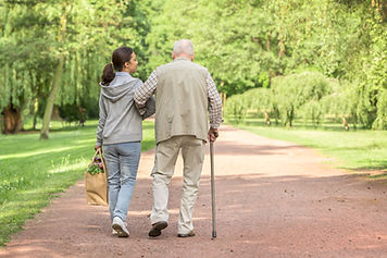 Two Persons Walking in the Park | Angel Heart Home Care | The Best Care for Your Loved Ones