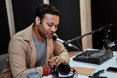 A young man in a recording studio