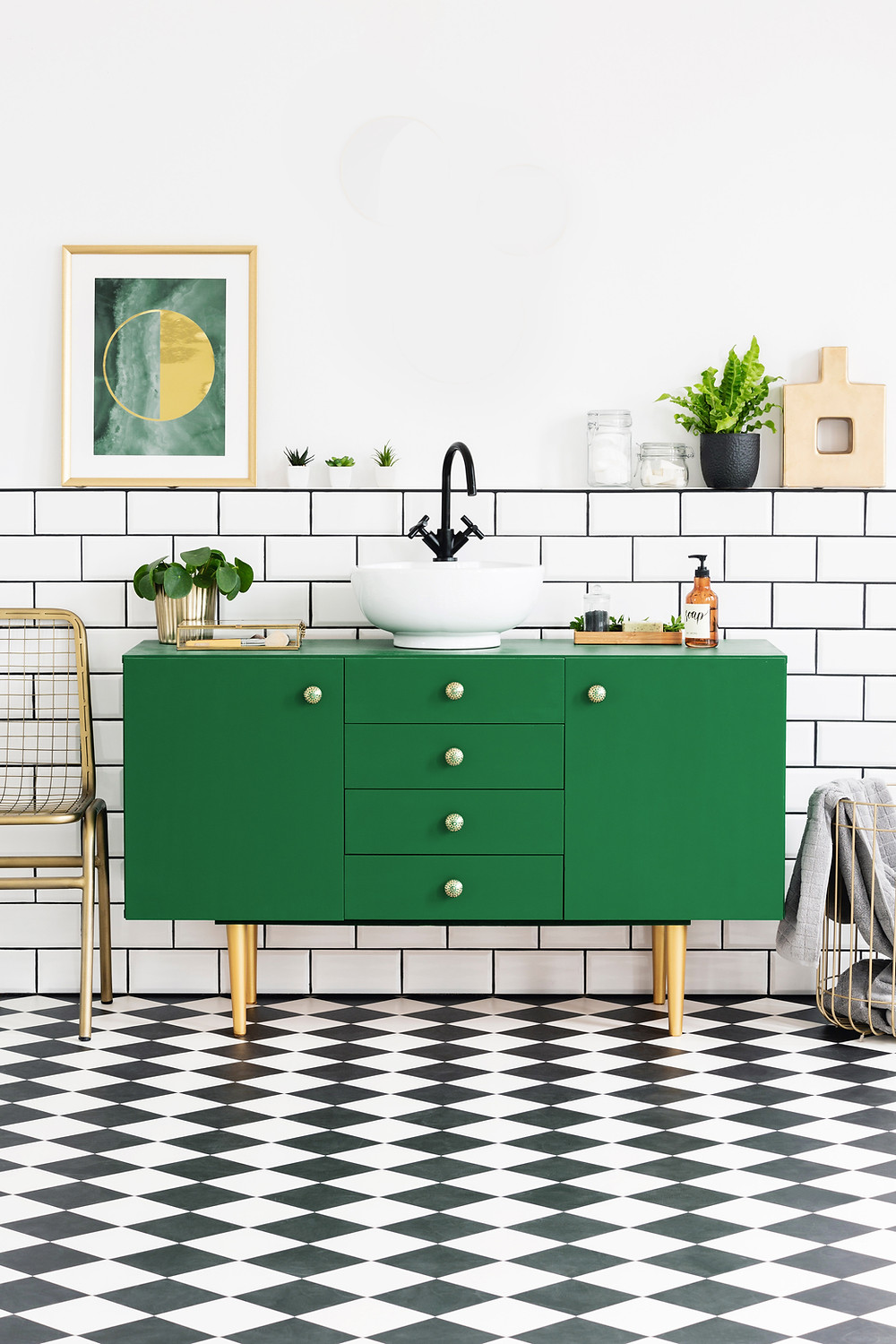 modern home with green sink and modern art and gold accessories