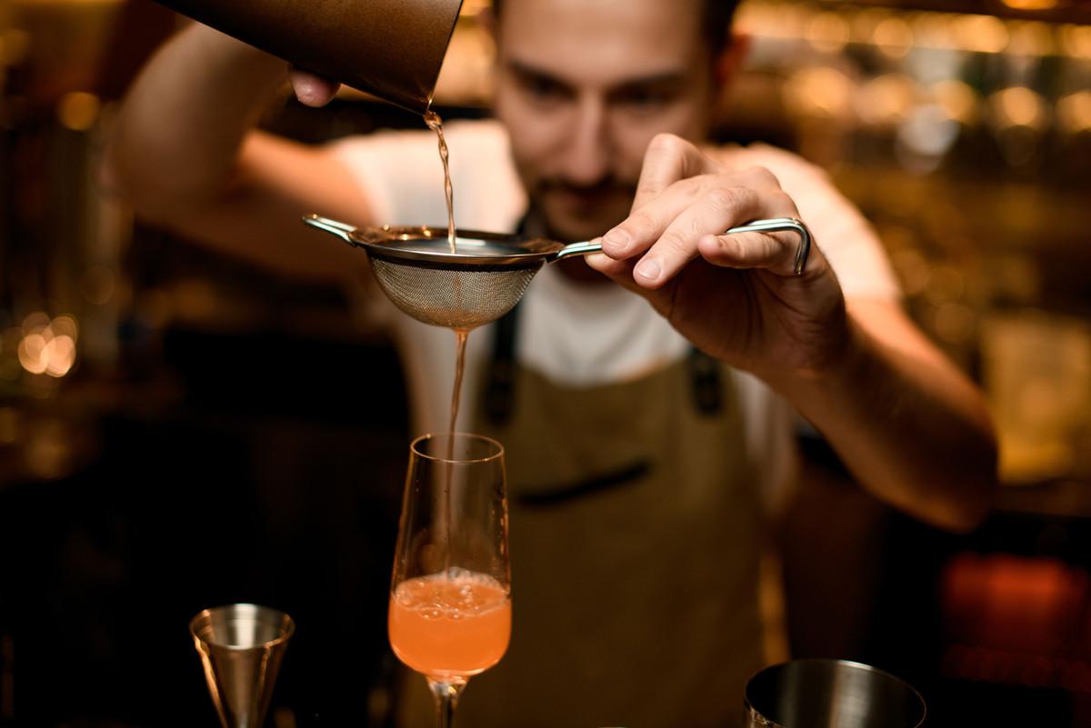 Mixologist Preparing a Drink