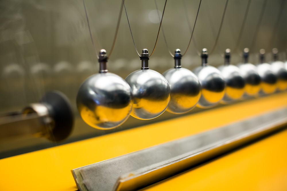 Newton's cradle is a law of physics. These principles equally apply to the law of humanity.
