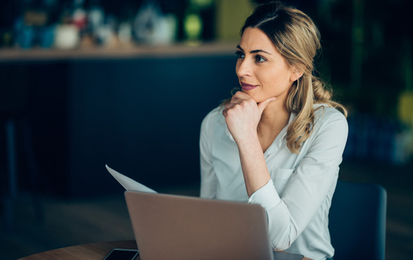 Woman at computer looking pleased