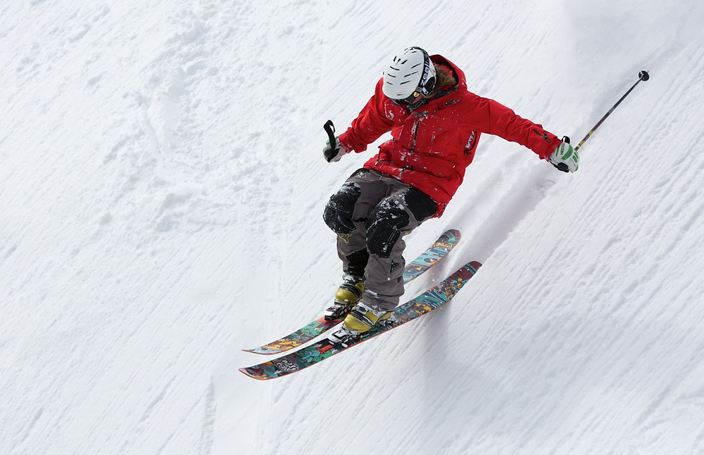 a person skiing down a very steep hill
