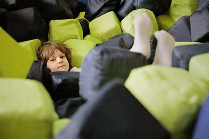 Boy Lying in Soft Cubes