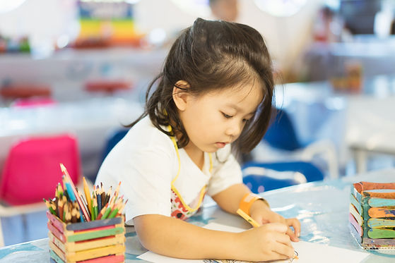 Kid Drawing With Colored Pencil