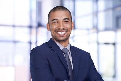 Smiling Businessman explaining Menity functional expertise