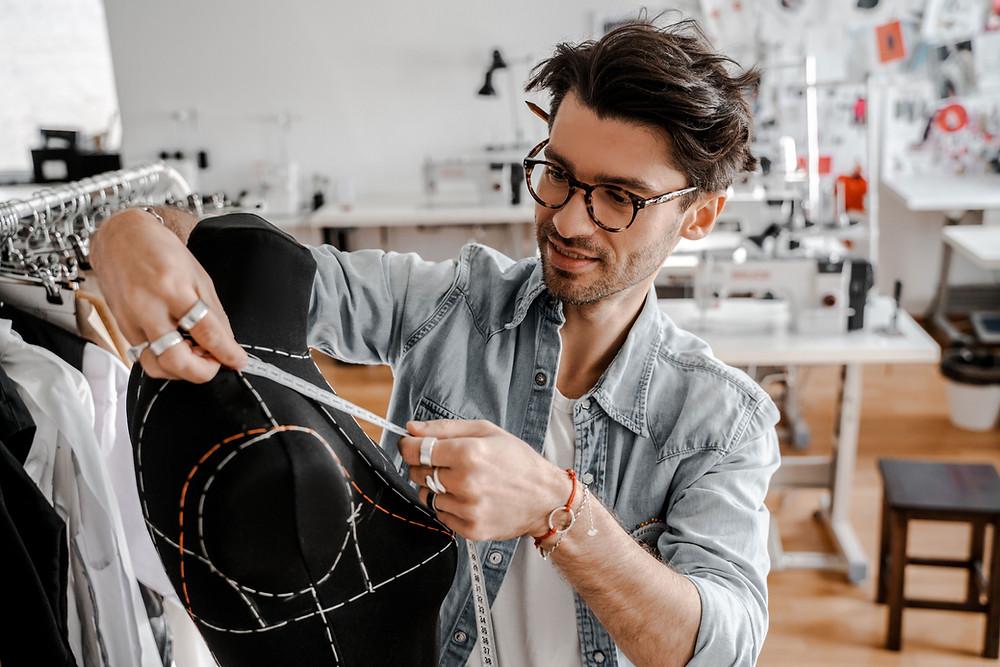 A fashion designer working in his studio