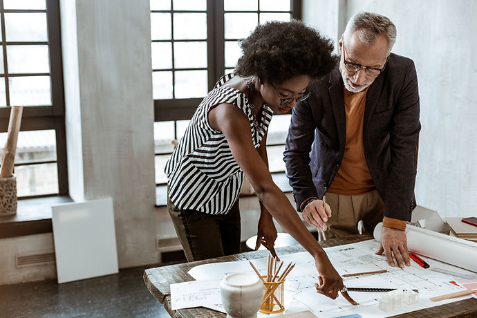 A Man and a Woman looking at a Design